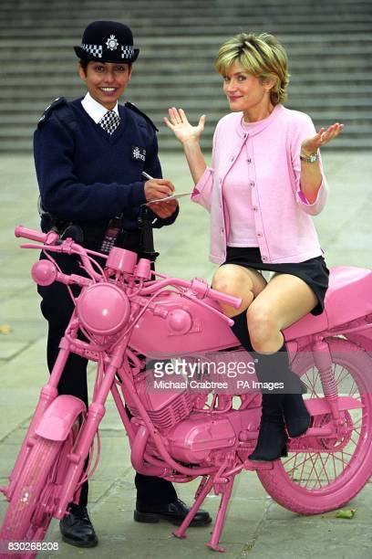 Television presenter Anthea Turner sat astride a lobster pink motorbike receiving a ticket from WPC Pepe Kaur at the official opening of 'Everyday...