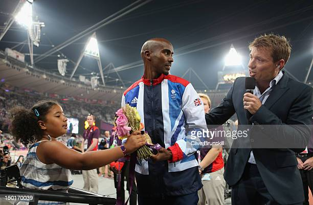 Television presenter Ben Shephard speaks wih gold medalist Mohamed Farah of Great Britain and his daughter Rihanna Farah after the medal ceremony for...