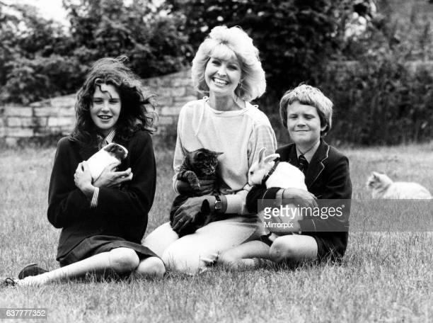 Television presenter Cathy Secker with Jane David a guinea pig cat and rabbit 11th July 1984