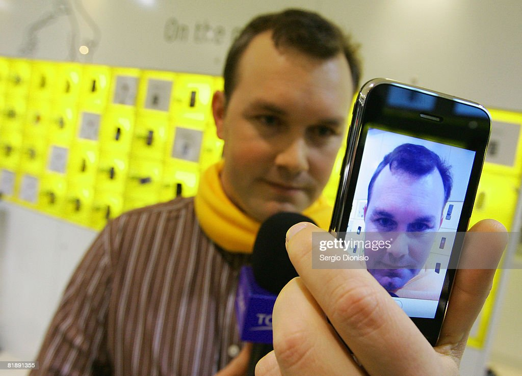 Television presenter Charlie Brown from the Today Show, test drives the new Apple iPhone at the George Street Optus Store on July 11, 2008 in Sydney, Australia. The iPhone 3G is a multimedia mobile device with a touch screen that enables email and web browsing.