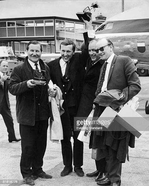 Television presenter David Frost at Heathrow airport with TV executives responsible for the comedy programme 'Frost Over England' which won the...