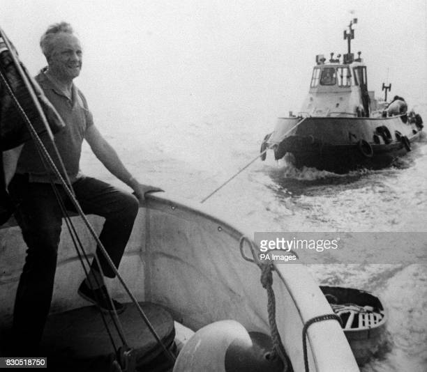Television presenter Hughie Green aboard his 54ft motor yacht Enalios off Lee on Solent Hampshire towing Ocelot a customs launch in which he rescued...