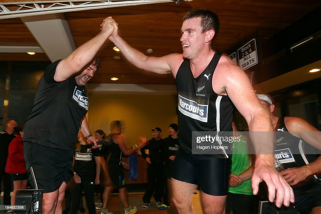 Television presenter James McOnie and rower Joseph Sullivan celebrate after winning the rowing leg of the ANZA Challenge on October 15, 2013 in Wellington, New Zealand.