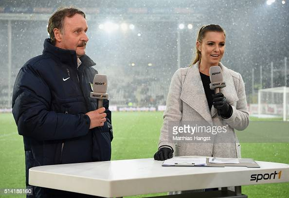 Television presenter Laura Wontorra and Peter Neururer seen prior to the Second Bundesliga match between SC Freiburg and RB Leipzig at...