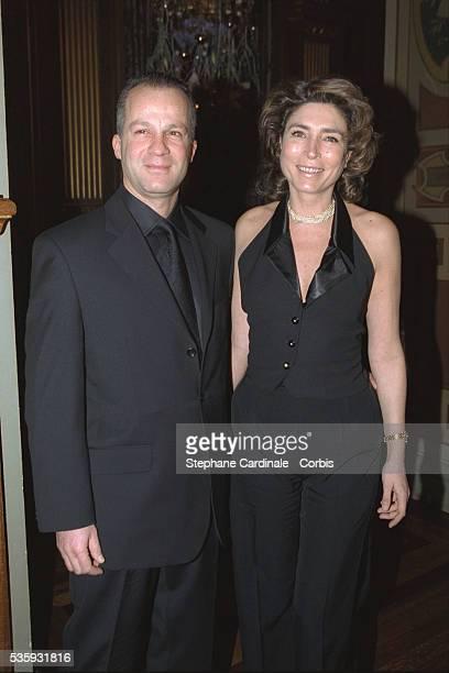 Television presenter MarieAnge Nardi and a friend at the 'Grand Prix d'Amerique' gala