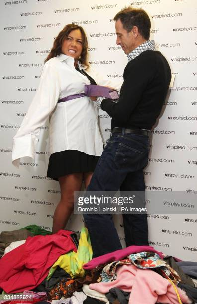 Television presenter Miquita Oliver wears a shirt and tie donated by Prime Minister Gordon Brown with fashion designer Ben De Lisi at the launch of...