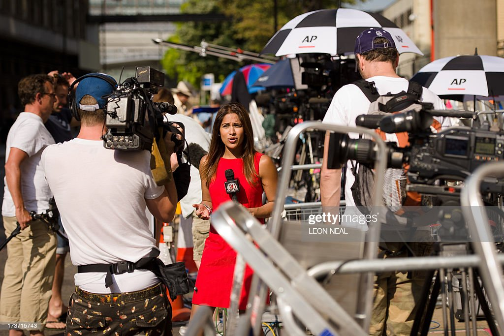 A television presenter records a piece to camera outside the Lindo Wing of St Mary's Hospital in London, on July 17, 2013, where Prince William and his wife Catherine's baby is expected to be born. Britain's Prince Charles joked Monday that his son Prince William's baby was 'hopefully' on the way, but wife Camilla went further, saying it could arrive 'by the end of the week'.