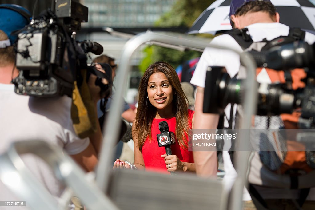 A television presenter records a piece to camera outside the Lindo Wing of St Mary's Hospital in London, on July 17, 2013, where Prince William and his wife Catherine's baby is expected to be born. Britain's Prince Charles joked Monday that his son Prince William's baby was 'hopefully' on the way, but wife Camilla went further, saying it could arrive 'by the end of the week'. AFP PHOTO / LEON NEAL