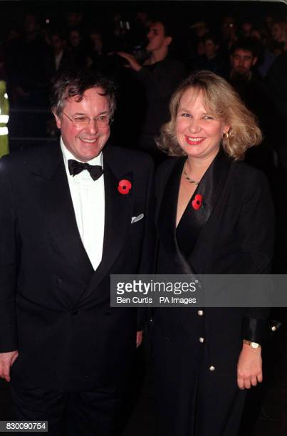 Television presenter Richard Whiteley and actress Kathryn Apanowicz arrive at the Royal Albert Hall in London for the National Television Awards