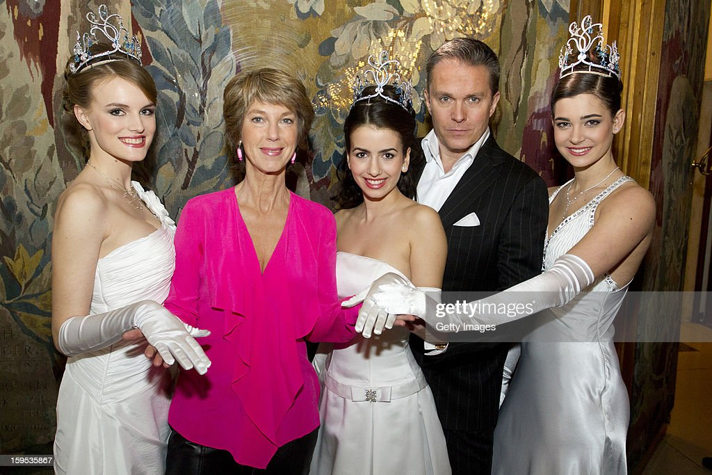 Television presenters Barbara Rett and Alfons Haider pose with pening ceremony debutants during the press conference ahead of the Vienna Opera Ball on January 15, 2013 in Vienna, Austria.