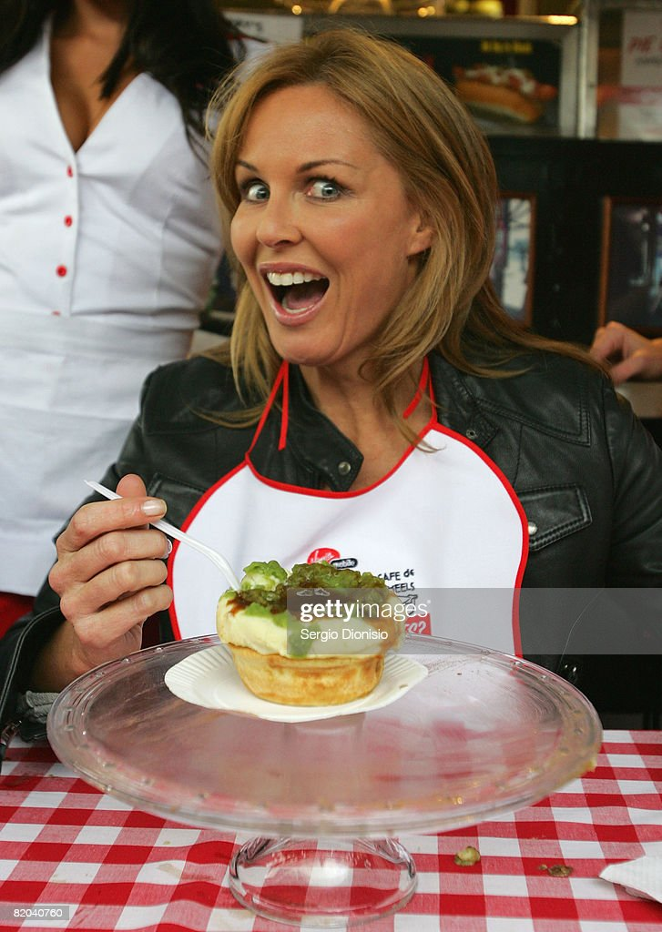 Television presenters Charlotte Dawson attends the Virgin Mobile pie eating competition at Harry's Cafe de Wheels on July 23 2008 in Sydney Australia