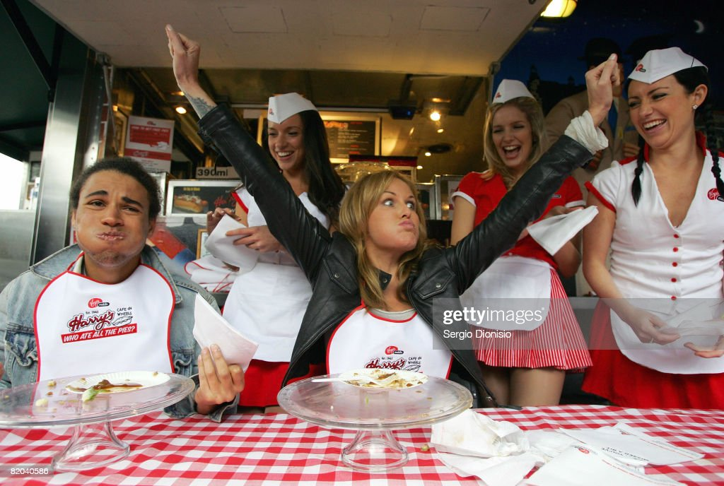 Television presenters Charlotte Dawson celebrates winning a pie eating contest against Kyle Linahan during the Virgin Mobile pie eating competition...