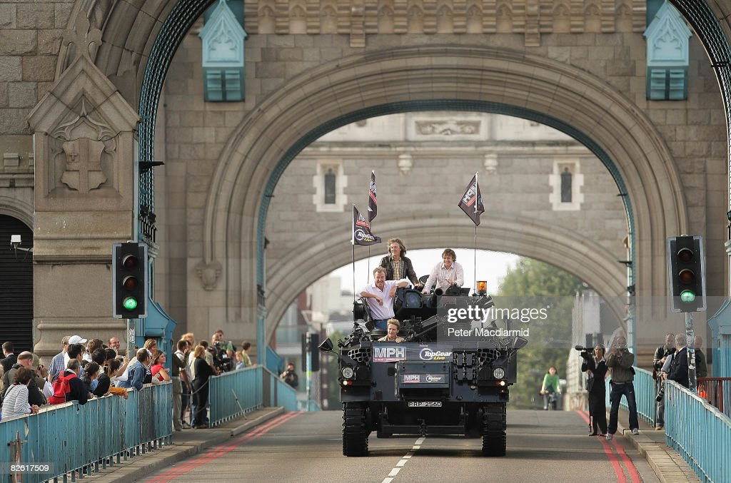 Television presenters Jeremy Clarkson Richard Hammond and James May cross Tower Bridge on a military vehicle on September 1 2008 in London The trio...