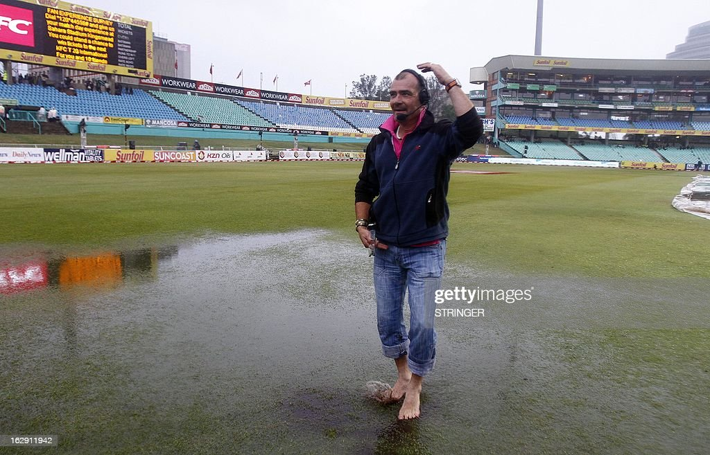 Television producer Rui Marques fools around in the rain during the 1st T20 match between South Africa and Pakistan on March 1, 2013 at Sahara Stadium in Durban, South Africa. Steady rain threatened to wash out the first Twenty20 international between South Africa and Pakistan at Kingsmead here on Friday.