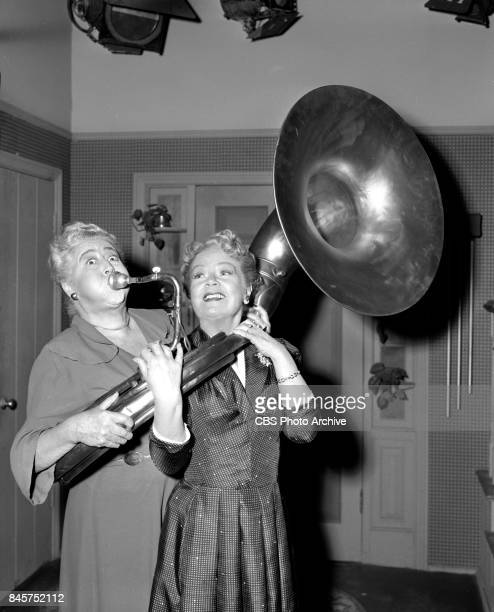 CBS television program December Bride Verna Felton plays a Sousaphone while Spring Byington helps hold the musical instrument Episode The Grandfather...