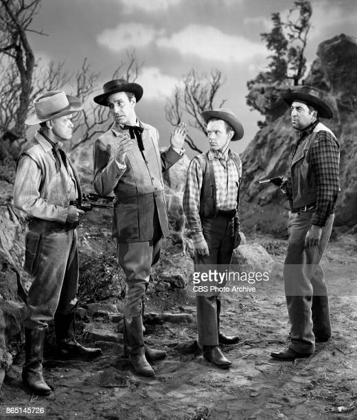 CBS television program 'Schlitz Playhouse of Stars episode The Bitter Land Group of four men left to right unconfirmed actor John Newland Jack Dimond...