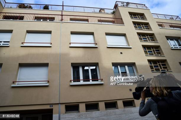 A television reporter films the appartments building on July 12 where late French magistrate JeanMichel Lambert was found dead at his home in Le Mans...