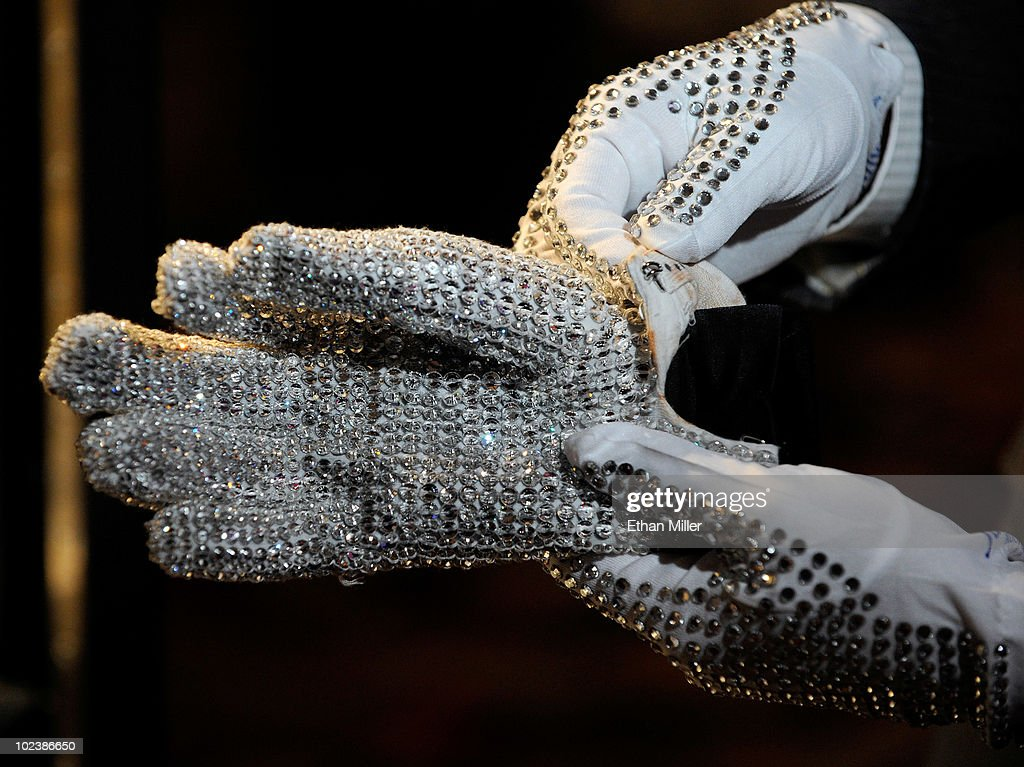 A television reporter from Japan holds a Michael Jackson Victory Tour glove covered in clear Swarovski crystals at Julien's Auctions annual summer sale at the Planet Hollywood Resort & Casino June 24, 2010 in Las Vegas, Nevada. The auction, which continues through Sunday, features 1,600 items from entertainers including Michael Jackson, Anna Nicole Smith, Star Trek creator Gene Roddenberry, Marilyn Monroe, Cher and Elvis Presley.