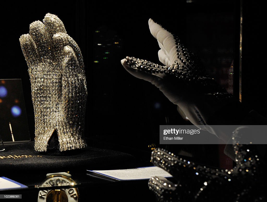 A television reporter from Japan reaches out to hold up a Michael Jackson Victory Tour glove covered in clear Swarovski crystals at Julien's Auctions annual summer sale at the Planet Hollywood Resort & Casino June 24, 2010 in Las Vegas, Nevada. The auction, which continues through Sunday, features 1,600 items from entertainers including Michael Jackson, Anna Nicole Smith, Star Trek creator Gene Roddenberry, Marilyn Monroe, Cher and Elvis Presley.
