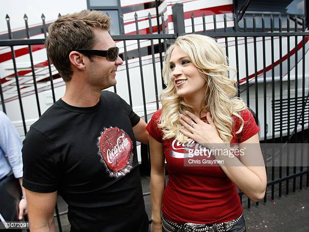 Television Ryan Seacrest and country singer Carrie Underwood visit track before the NASCAR Nextel Cup Series CocaCola 600 at the Lowe's Motor...