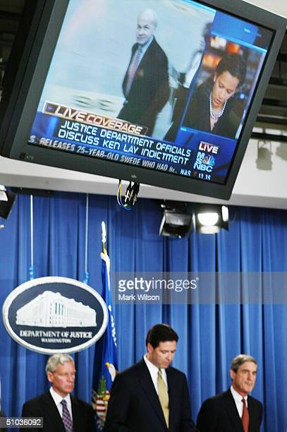 A television sceen shows Ken Lay above Deputy Attorney General James B Comey as he reads the indictment of the former Enron CEO Kenneth Lay as IRS...