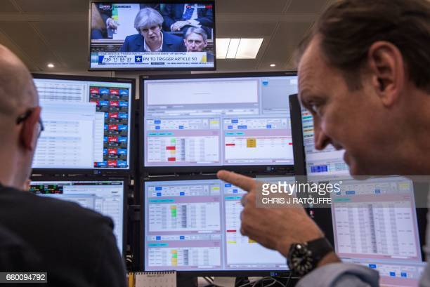 A television screen displays an image of British Prime Minister Theresa May as she speaks during Prime Minister's Questions in the Houses of...