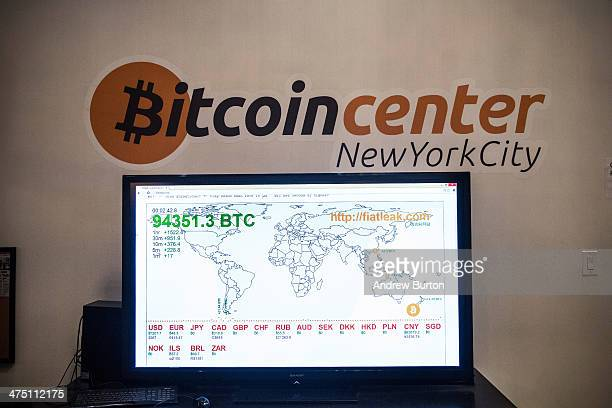 A television screen displays various bitcoin rates at Bitcoin Center NYC during a class on the basics of Bitcoin and how to trade the digital...