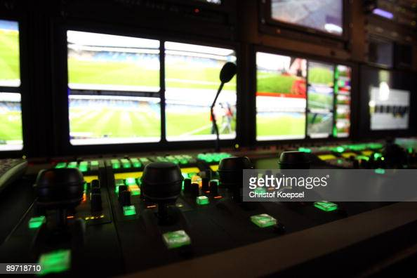 Television screens of a television company are seen in a production lorry before the Bundesliga match between VfL Bochum and Borussia...
