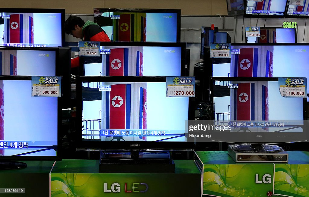 Television screens show a news broadcast on North Korea's rocket launch at an electronics store in Seoul, South Korea, on Wednesday, Dec. 12, 2012. North Korea launched a long-range rocket today in defiance of international sanctions, an indication the totalitarian regime is making progress in its ballistic missile technology. Photographer: SeongJoon Cho/Bloomberg via Getty Images