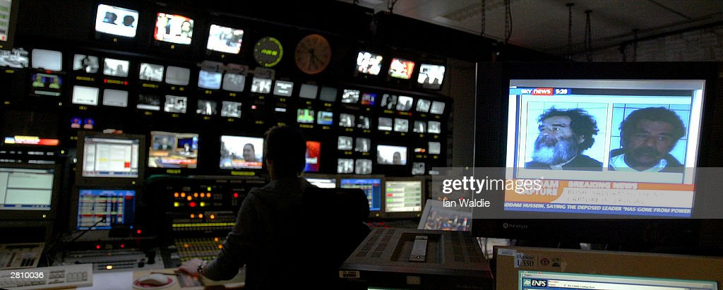 Television screens show images of former Iraqi dictator Saddam Hussein in the control room of ITN (Independent Television News) during their news progamming December 14, 2003 in London. Saddam was captured by US forces during a raid near his home town of Tikrit.