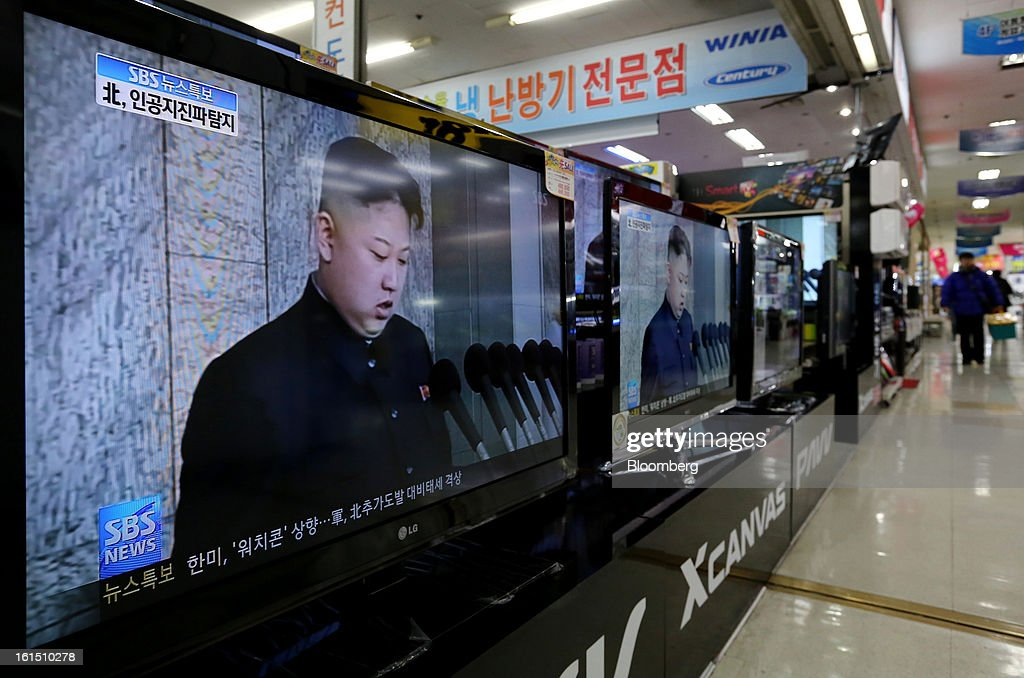 Television screens show images of Kim Jong Un, leader of North Korea, as they show a news broadcast on North Korea's nuclear test at an electronics store in Seoul, South Korea, on Tuesday, Feb. 12, 2013. North Korea held its third nuclear test today, underscoring a disregard for an international community that has already isolated the totalitarian state from the global economy. Photographer: SeongJoon Cho/Bloomberg via Getty Images