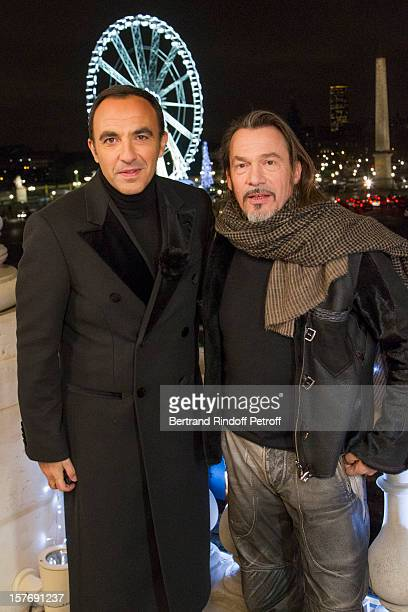 Television show host Nikos Aliagas and singer Florent Pagny attend the shooting of the year end program 'Toute la musique qu'on aime ' set to be...