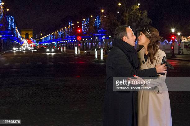 Television show hosts Nikos Aliagas and Karine Ferri exchange a New Year kiss as they attend the shooting of the year end program 'Toute la musique...