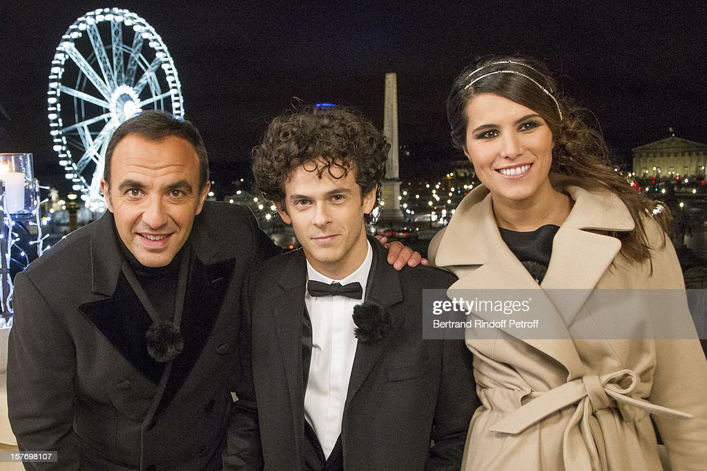 Television show hosts Nikos Aliagas (L), Karine ferri (R) and impersonator and singer Michael Gregorio attend the shooting of the year end program 'Toute la musique qu'on aime !' set to be broadcast on New Year's Eve on French private channel TF1, at Hotel Crillon on December 4, 2012 in Paris, France.