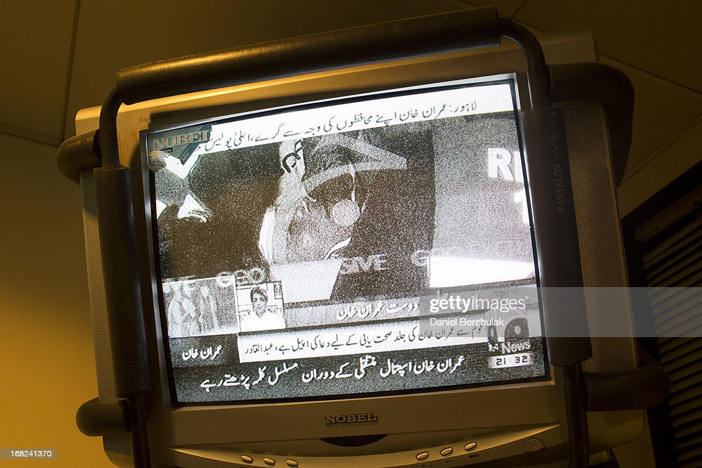 A television shows an image of Imran Khan, chairman of the Pakistan Tehrik e Insaf (PTI) party, laying on a stretcher after being injured from falling off a lifter during an election campaign rally on May 07, 2013 in Lahore, Pakistan. PTI chairman Imran Khan was injured at a rally in Lahore today after having fallen departing the stage. Pakistan's parliamentary elections are due to be held on May 11. Imran Khan of Pakistan Tehrik e Insaf (PTI) and Nawaz Sharif of the Pakistan Muslim League-N (PMLN) have been campaigning hard in the last weeks before polling.