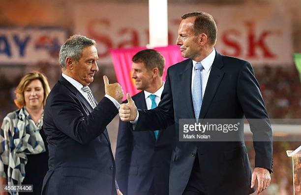 Television sports presenter Ken Succliffe greets Australian Prime Minister Tony Abbott after the 2014 NRL Grand Final match between the South Sydney...