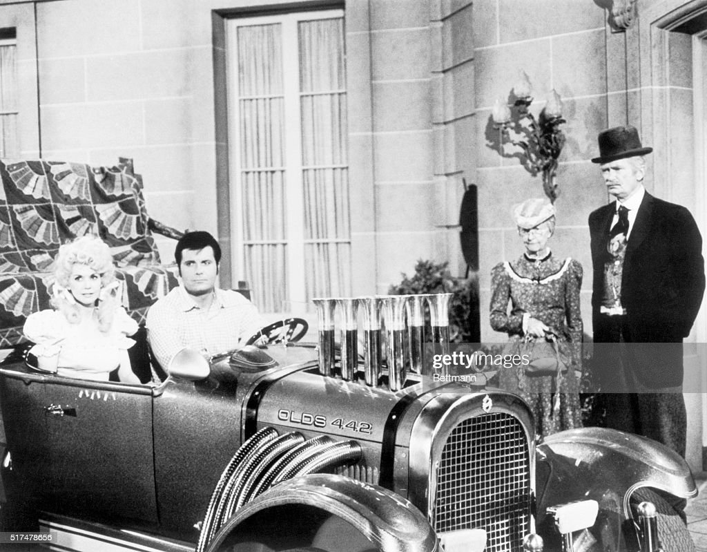Television still from The Beverly Hillbillies. In this scene, <a gi-track='captionPersonalityLinkClicked' href=/galleries/search?phrase=Donna+Douglas&family=editorial&specificpeople=990336 ng-click='$event.stopPropagation()'>Donna Douglas</a> as Elly May and Max Baer, Jr., as Jethro Bodine are seated in an automobile. Irene Ryan as granny and <a gi-track='captionPersonalityLinkClicked' href=/galleries/search?phrase=Buddy+Ebsen&family=editorial&specificpeople=894081 ng-click='$event.stopPropagation()'>Buddy Ebsen</a> as Jed Clampett are standing beside them.