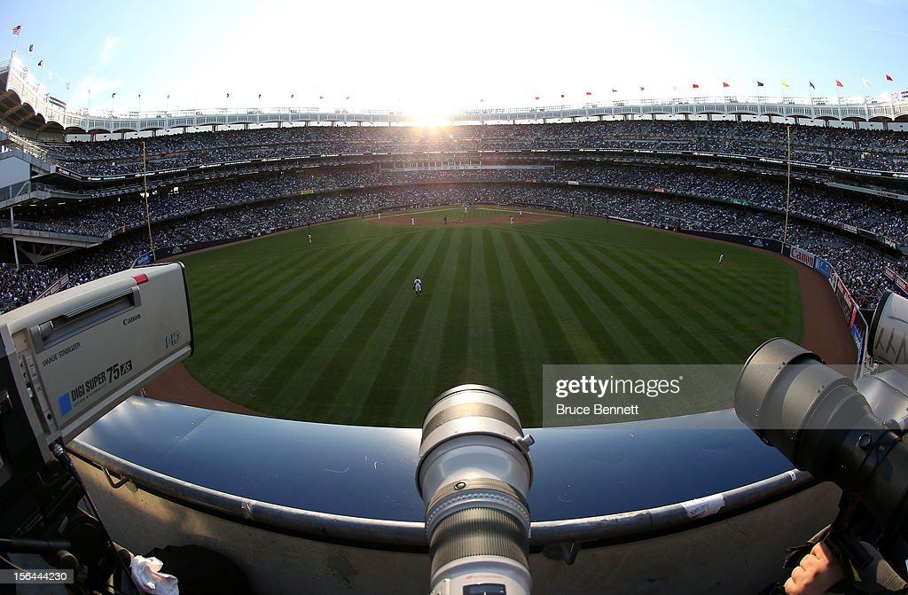 Television video and still camera lenses are seen in centerfield as the sun sets behind home plate while the New York Yankees host the Detroit Tigers during Game Two of the American League Championship Series at Yankee Stadium on October 14, 2012 in the Bronx borough of New York City.
