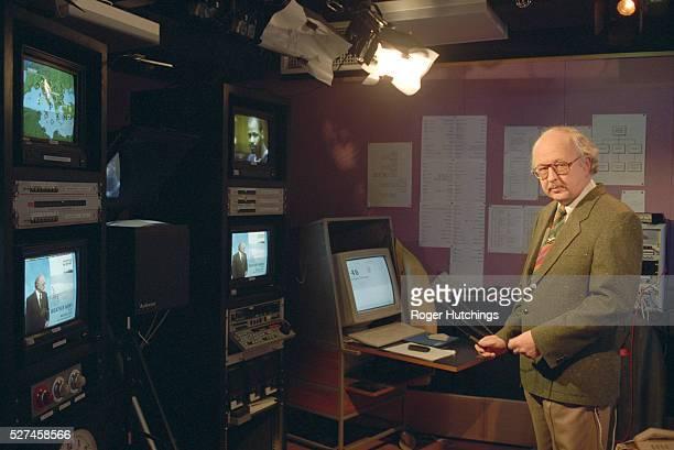 Television weathermen preparing and presenting the weather forecast on television at the Weather centre at BBC TV Centre in Shepherds Bush London