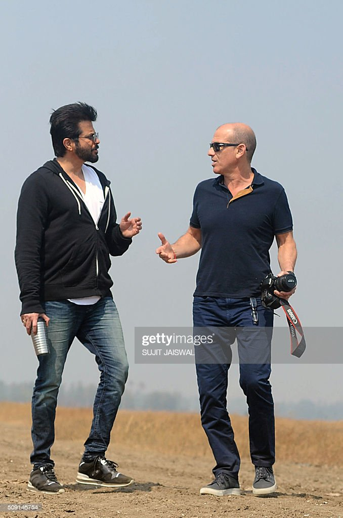 US television writer and producer Howard Gordon (R) and Indian Bollywood actor Anil Kapoor pose for the media on location for the Indian Hindi version of the hit counter terrorism show '24' as season 2 is being made, in Mumbai on February 9, 2016. AFP PHOTO / Sujit Jaiswal / AFP / SUJIT JAISWAL