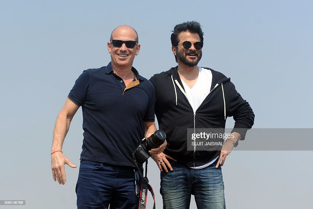 US television writer and producer Howard Gordon (L) and Indian Bollywood actor Anil Kapoor pose for the media on location for the Indian Hindi version of the hit counter terrorism show '24' as season 2 is being made, in Mumbai on February 9, 2016. AFP PHOTO / Sujit Jaiswal / AFP / SUJIT JAISWAL