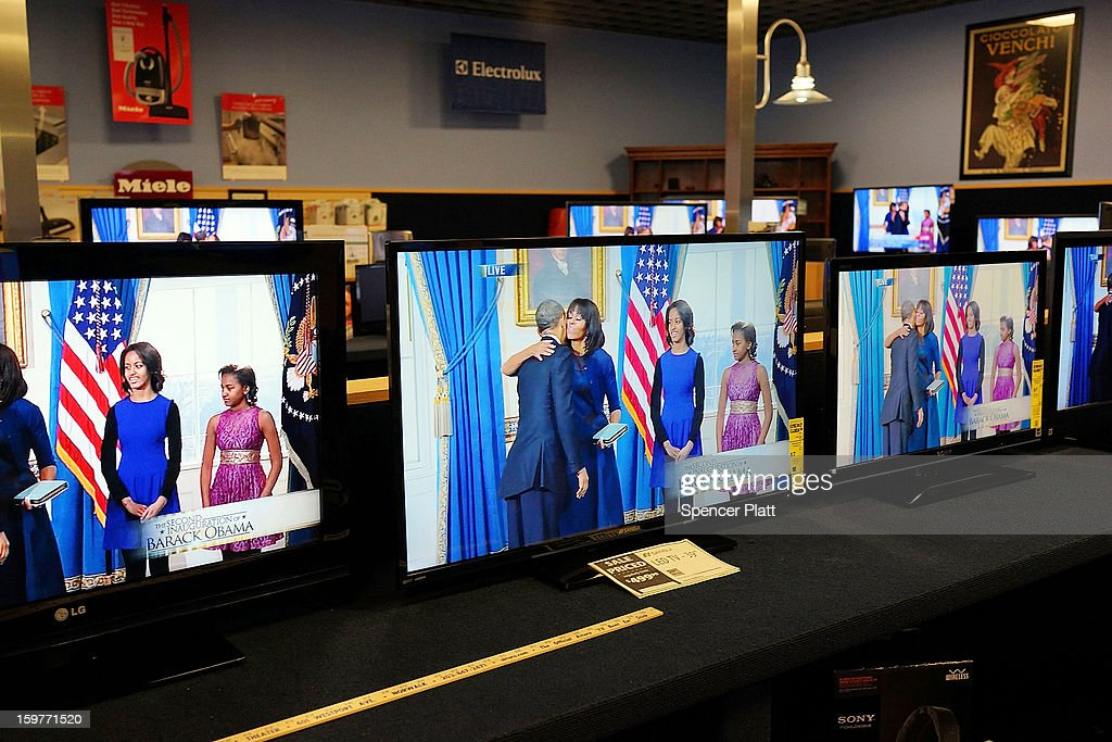 Televisions show the swearing-in of U.S. President Obama at Aitoro appliance store on January 20, 2013 in Norwalk, Connecticut. Both President Obama and Vice President Biden were formally sworn into office today, marking the official beginning of their second terms in office.