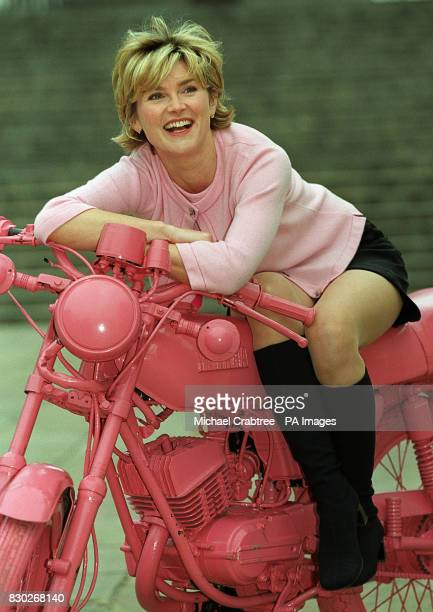 Televison presenter Anthea Turner sat astride a lobster pink motorbike at the official opening of 'Everyday Icons' sponsored by the personal care...