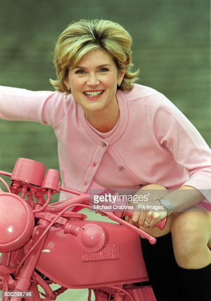Televison presenter Anthea Turner sat astride a pink motorbike at the official opening of 'Everyday Icons' sponsored by the personal care brand Dove...