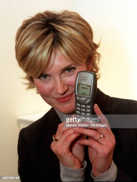 Televison presenter Anthea Turner who launched the 'Everyday Icons' exhibition shows her own choice of icon a mobile phone The exhibition sponsored...