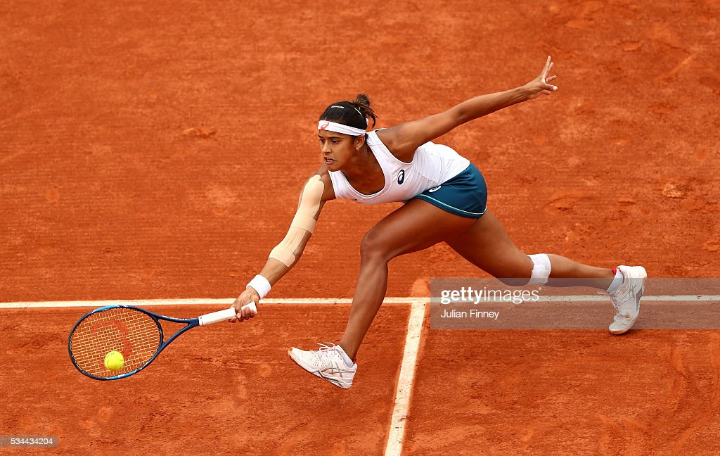 Teliana Pereira of Brazil stretches for a forehand during the Ladies Singles second round match against Serena Williams of the United States on day five of the 2016 French Open at Roland Garros on May 26, 2016 in Paris, France.