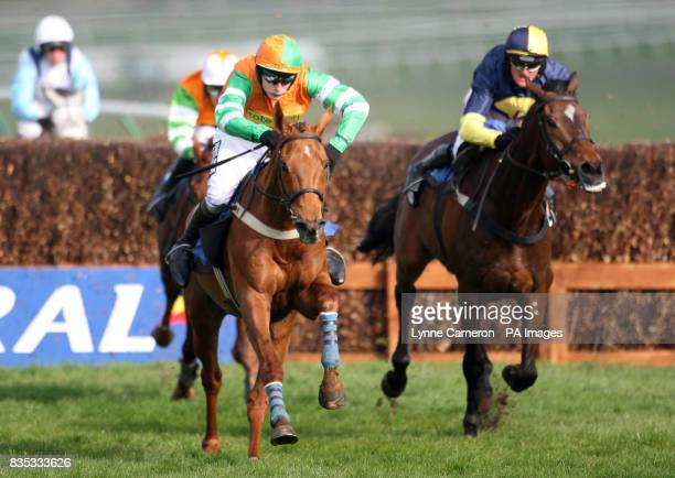 Tell Henry ridden by James Reveley recovers to go on to win the Hillhouse Quarry Handicap Chase during Day One of the Coral Scottish Grand National...