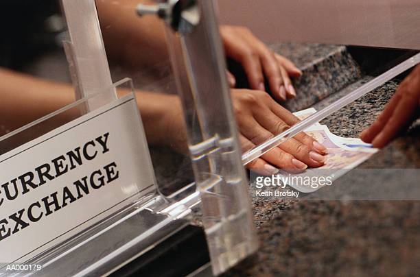Teller Exchanging Money at a Currency Exchange