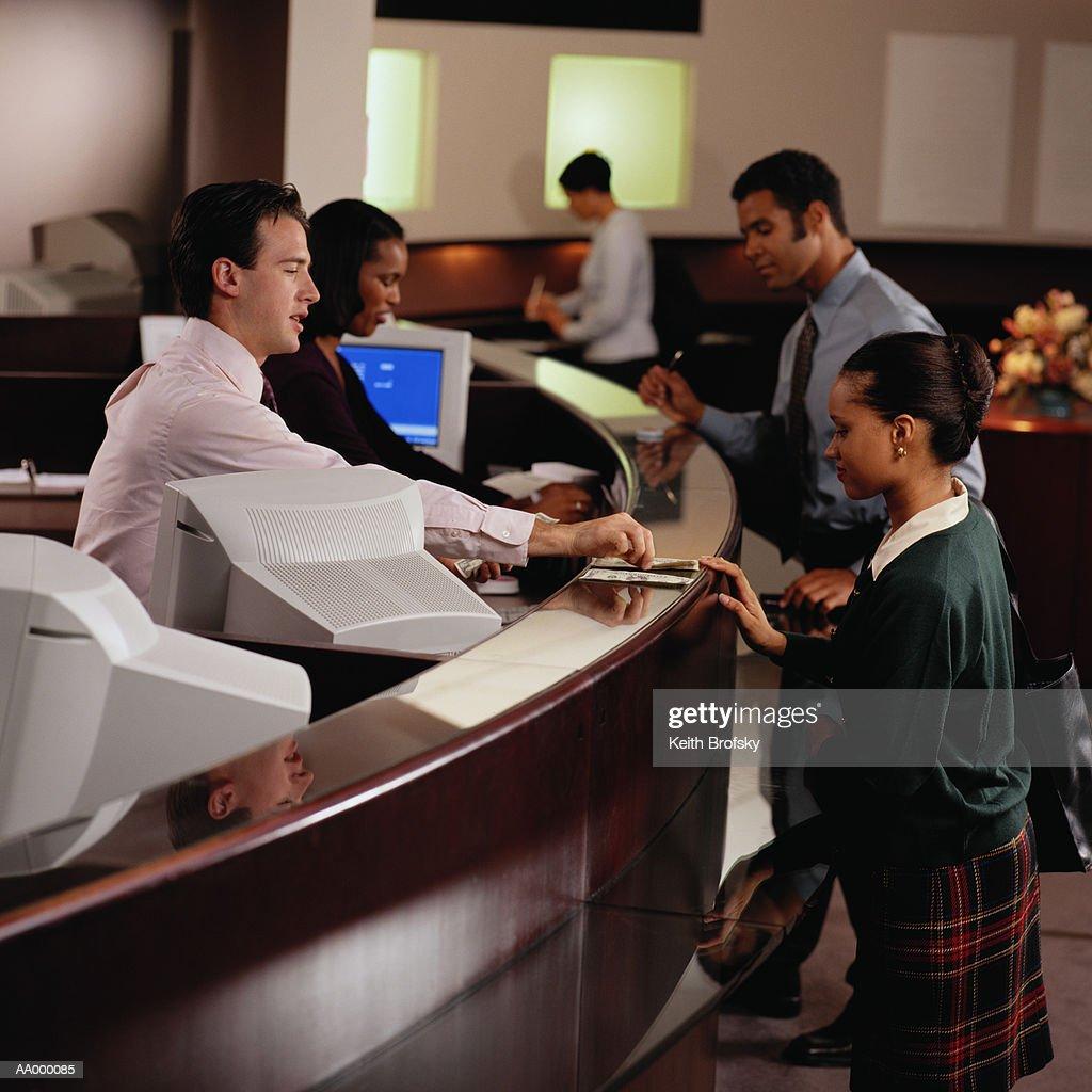 Teller Giving Woman at a Bank Money
