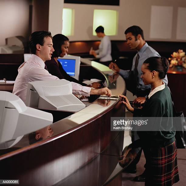 Teller Giving Woman at a Bank Money